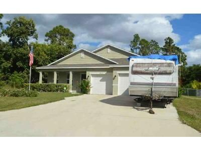 4 Bed 3 Bath Foreclosure Property in Port Saint Lucie, FL 34953 - SW Calah Cir