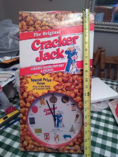 Collectible 1999 cracker Jack clock in original box. The cracker Jack's are gone but box and clock are together . New!