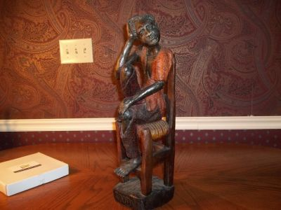 WOODEN HAND CARVED AFRICAN MAN IN CHAIR VERY DETAILED