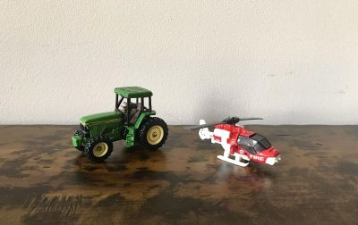 Die Cast Tractor and Metal/Plastic Red/White Fire Helicopter that White Tail part extends out or can be in like the picture