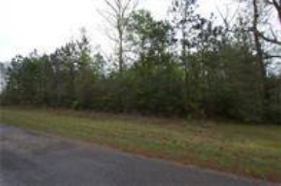 2211 County Road 3011 Dayton, beautiful 10.16 wooded acres