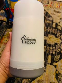 Tommee tippee travel bottle/food pouch warmer.