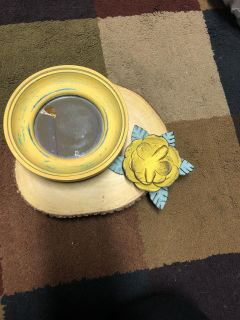 Yellow mirror and metal accent