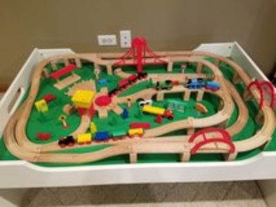 wooden train table with trains