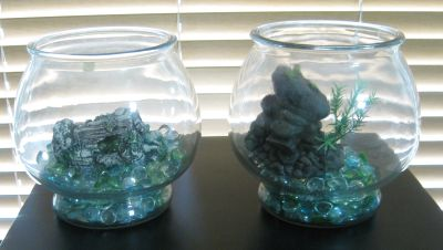 TWO FISH BOWLS WITH GEMS AND A HIDEOUT SCULPTURE (H)