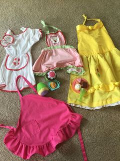 Dress up. 3 child aprons, nurse costume and play food $12
