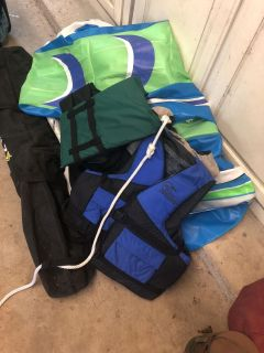 3 life jackets and blow up jet ski pull behind with ski