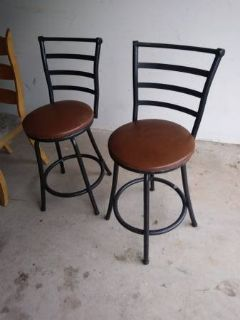 2 swivel black and brown bar stools with back