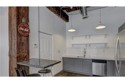 Contemporary Loft Living in historic John Deere Factory. Parking Available!
