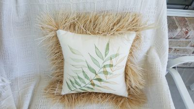 Throw pillow with fringe. There is not a removable cover.