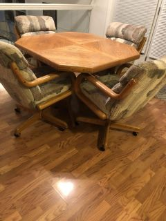 Dinette set with leaf and six rolling chairs