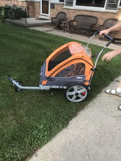 Jogging/bike stroller. In excellent condition. Tires are in excellent shape. Will hold two kids.