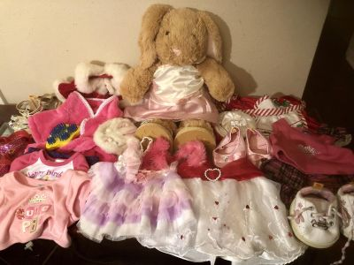 Build a Bear Bunny with assortment of clothes and shoes. EUC