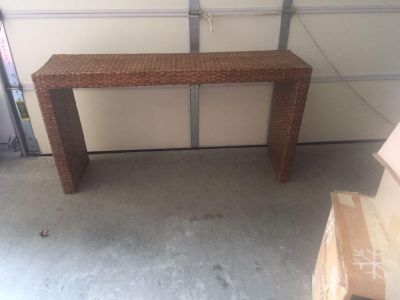 Wicker sofa table or can be used for anyplace
