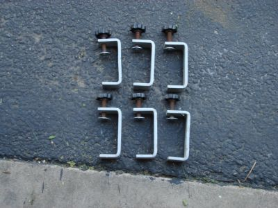 SIX MOUNTING CLAMPS FOR TRUCK CAMPER TOPS.