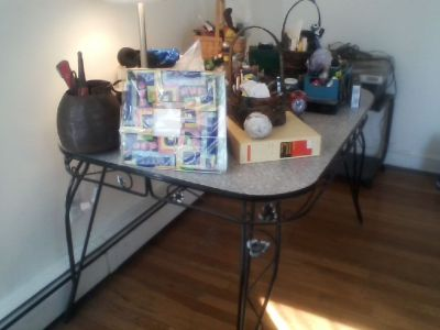 free vintage 50s kitchen table w/ w/ ornamented base & legs + recumbent tunturi exercise bike