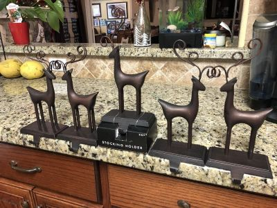 Stocking holders. Bronze, 10 tall, weighted