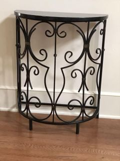 Beautiful, small wrought iron and marble console table in great condition (there is a small nick on top). 20.5 x 10.5 x 24.5