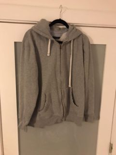 Tommy Hilfiger zippered, hooded grey sweatshirt. Excellent condition.