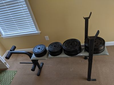Workout Bench & lot of barbells