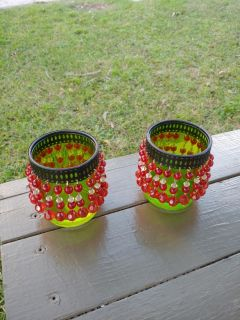 2 Green glass candle holders with decor