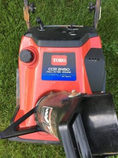 Toro 2450 snow blower starts and runs good very good paddles summer time special
