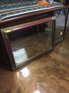 Large ornate and distressed mirror