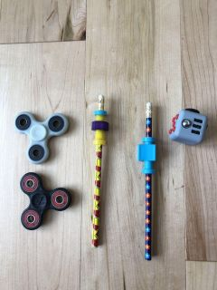 Fidget spinners, block, and pencils
