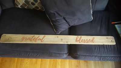 Handpainted sign on reclaimed wood