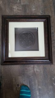 Square frame and round mirror