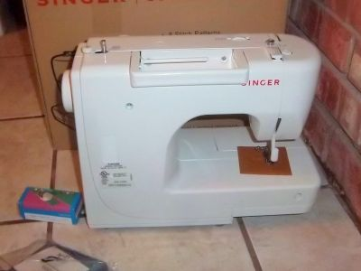 Brand new Singer sewing machine with attachments and instructions