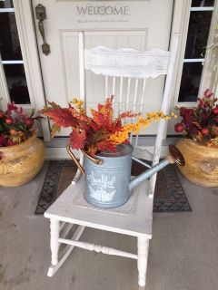 Antique Cream Distressed Rocker With Fall Watering can Decoration