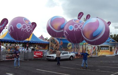Use JD Inflatables Custom Helium Products to Double Promotions at Public Places