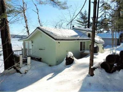 Beautiful Cobbossee Lake Cottage for sale located at 150 Heritage Woods Lane in