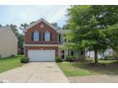This beautiful Four BR/2.5 BA brick home offers an...