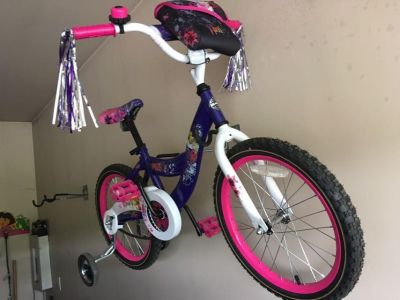 EUC - Huffy Girls bike with training wheels (removable) Only rode a couple of times. Would work for a 6-7 year old.