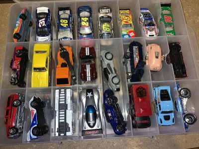 48 Hot Wheel Cars and Double Sided Storage Bin