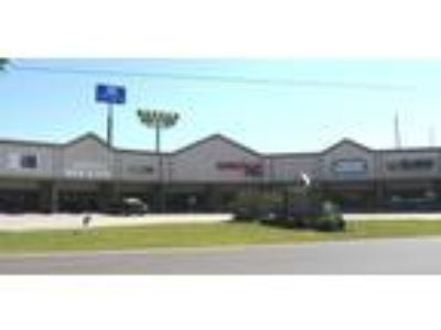 West Monroe, Large open retail space with glass storefront;