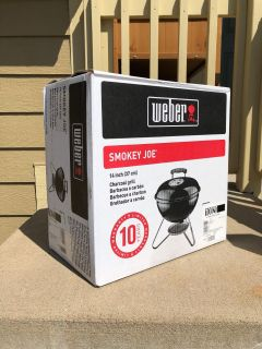 BRAND NEW in box Weber Smokey Joe 14 charcoal grill great for tailgating!!! Paid $60- PRICE firm and final- priced for quick sale