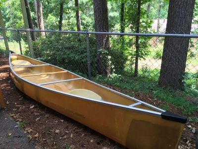 We-No-Nah canoe with paddles and accessories