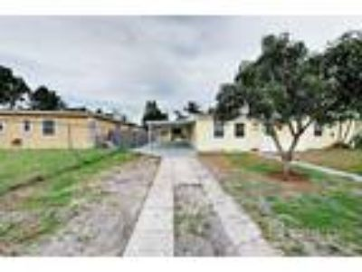 Four BR Two BA In Miami Gardens FL 33056