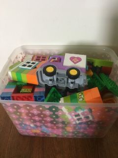 Box of LEGO Duplos with Doc McStuffins characters