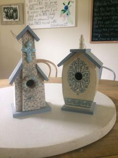 Two wooden painted bird houses
