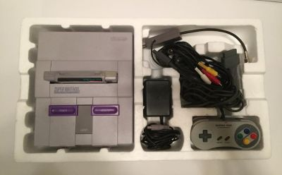 SNES complete in box and games