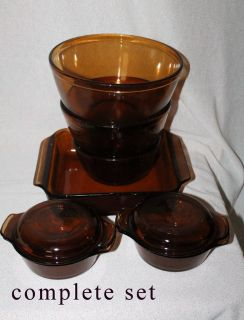 amber cookware & glasses many pieces