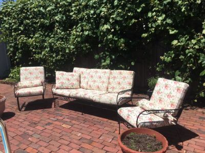 Patio furniture with pillows and cushions