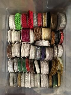 Lot of 50 Assorted Rolls do Embellishment trim. Most are unopened or unused. All for $20.00. Above Landa Park