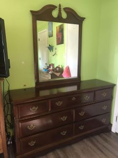 Dresser with mirror. All drawers work perfectly.Price is firm!!