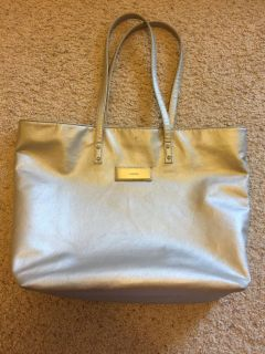 Silver Calvin Klein tote. About 18x13x5. Good used condition.