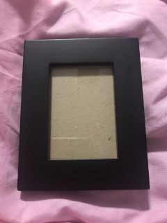 Small black wooden wallet size picture frame with a nice weight to it